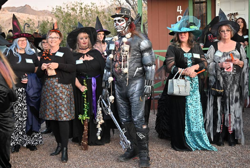 Richard Stephens/Special to the Pahrump Valley Times Witches and a warlock gather in front of S ...