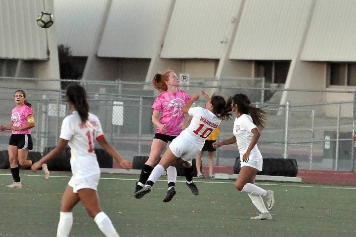 Horace Langford Jr./Pahrump Valley Times Pahrump Valley junior Makayla Gent collides with Weste ...