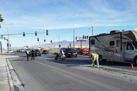 Selwyn Harris/Pahrump Valley Times Workers from a local concrete company clean up gravel after ...