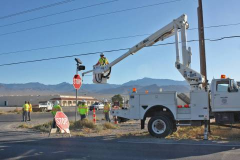 Robin Hebrock/Pahrump Valley Times While installing new stop signs on Calvada Boulevard, road c ...