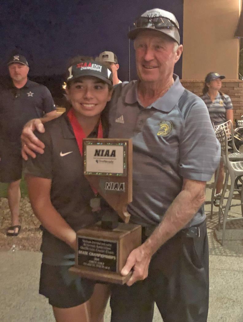 Tom Rysinski/Pahrump Valley Times Pahrump Valley junior Breanne Nygaard and golf coach Bob Hopk ...