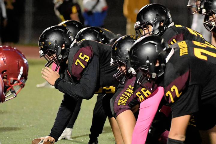 Peter Davis/Special to the Pahrump Valley Times Offensive linemen Caleb Sproul (72), Anthony Pe ...