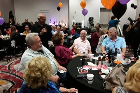 Selwyn Harris/Pahrump Valley Times Dick Duffin, center, reacts to his $10,000 windfall toward t ...