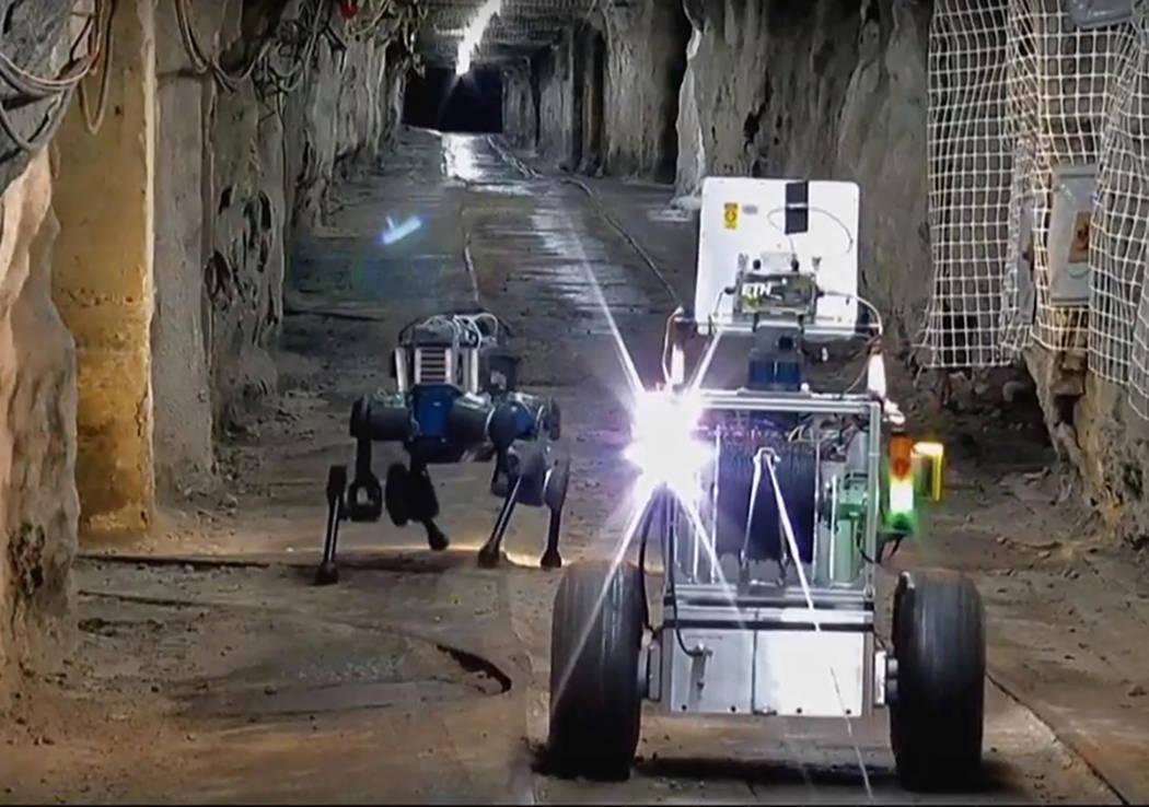 University of Nevada, Reno Using their legged robots, a wheeled communications vehicle, one adv ...