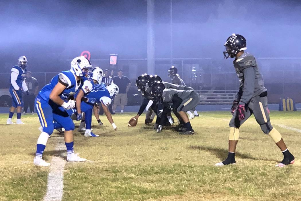 Justin Emerson/Las Vegas Review-Journal Moapa Valley football players, left, line up against Ch ...