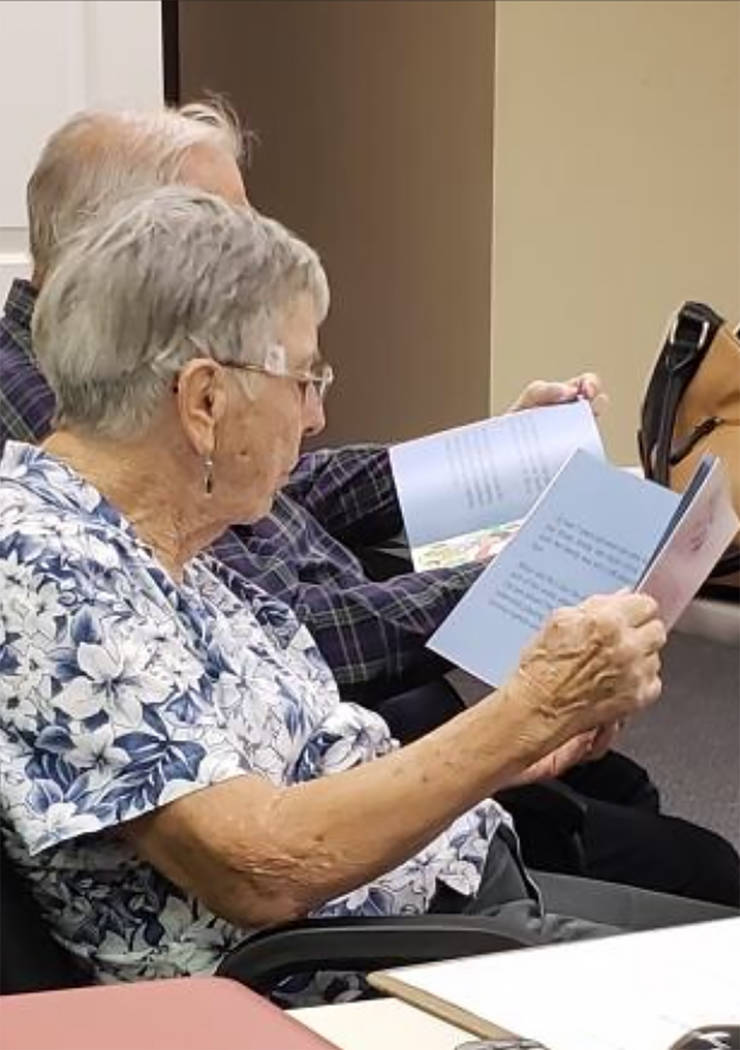 Special to the Pahrump Valley Times CASA advocates are seen reading the new books donated by th ...