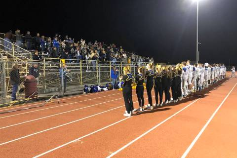 Tom Rysinski/Pahrump Valley Times Moapa Valley players, cheerleaders and fans sing the school s ...