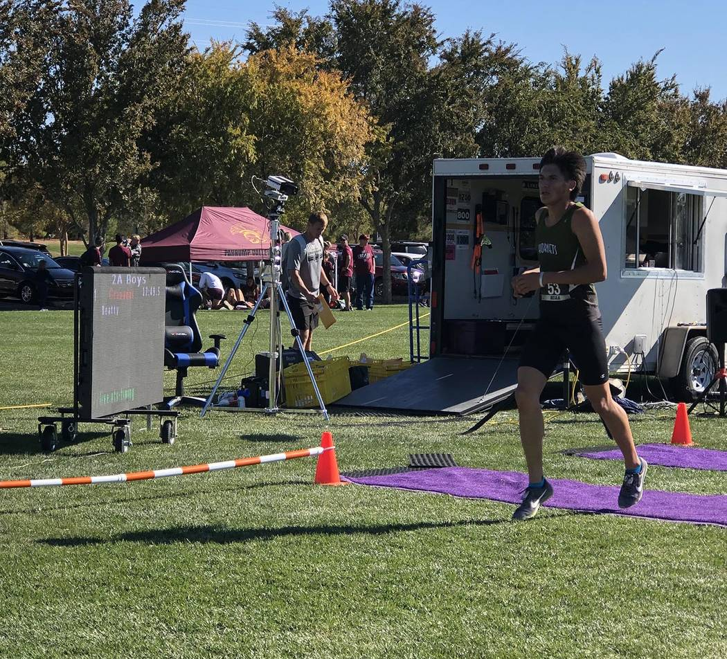 Tom Rysinski/Pahrump Valley Times Beatty senior Jose Granados crosses the finish line as the el ...