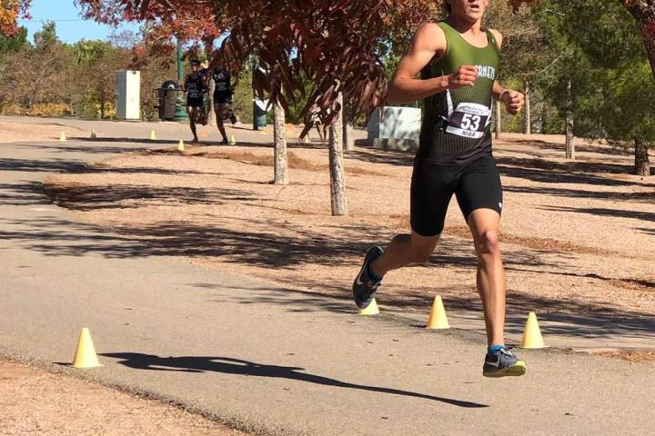 Tom Rysinski/Pahrump Valley Times Beatty High School senior Jose Granados leads the pack early ...