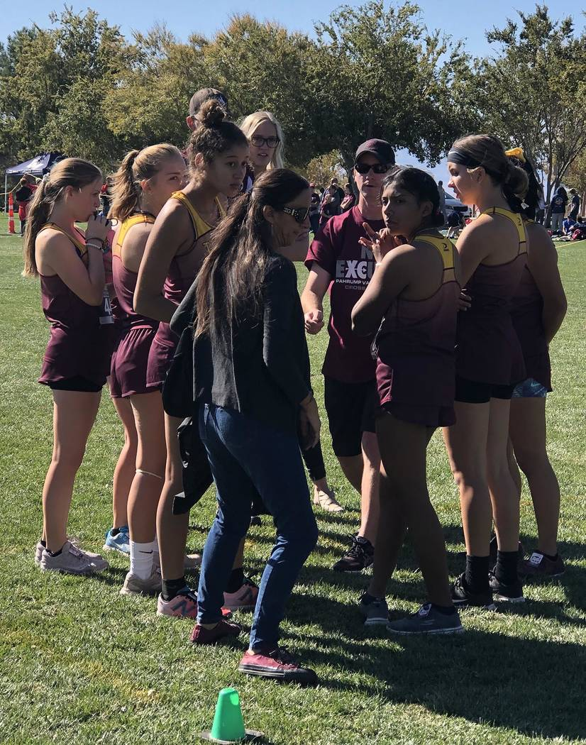 Tom Rysinski/Pahrump Valley Times The Pahrump Valley High School girls cross country team gets ...