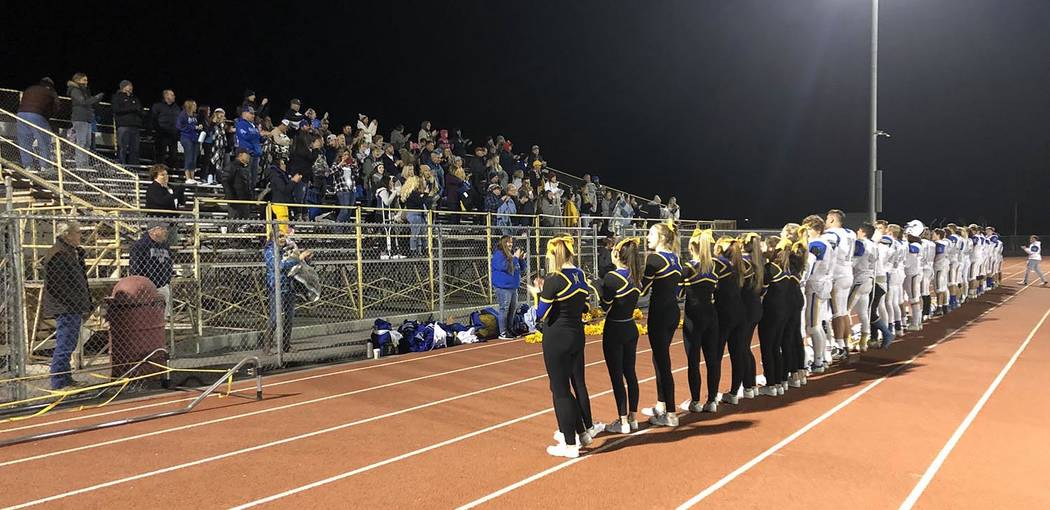 Tom Rysinski/Pahrump Valley Times Moapa Valley fans, cheerleaders and players join in singing t ...