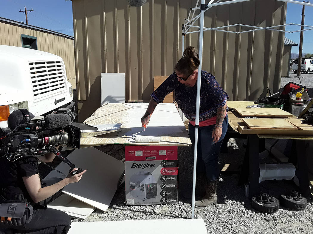 Selwyn Harris/Pahrump Valley Times A nomad volunteer applies paint to what will eventually beco ...