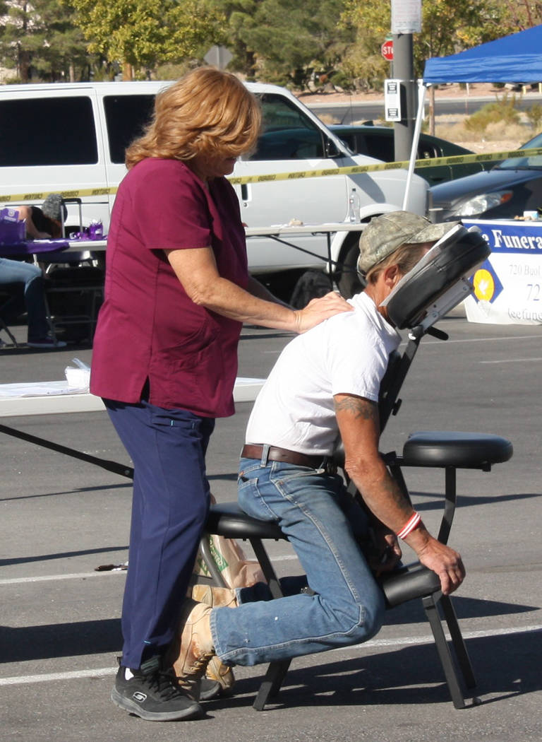 Robin Hebrock/Pahrump Valley Times Sheri Zartarian of Got Knots Massage was out providing relax ...