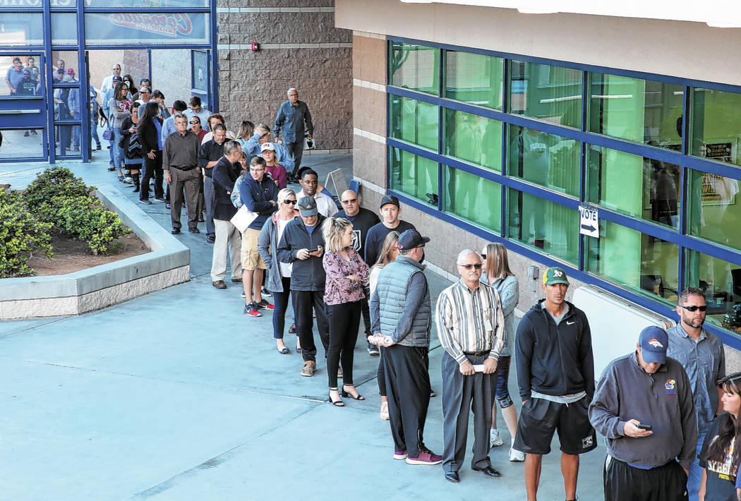 Voters lined up to cast their vote at a polling station at Coronado High School on Tuesday, Nov ...