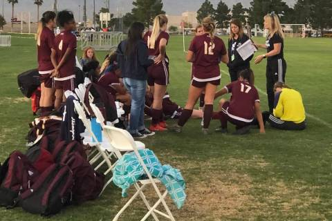 Tom Rysinski/Pahrump Valley Times Pahrump Valley High School girls soccer players gather around ...