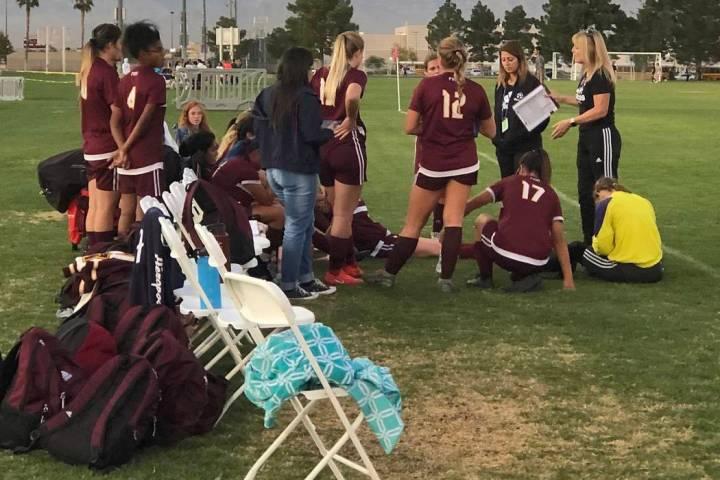 Tom Rysinski/Pahrump Valley Times Pahrump Valley High School girls soccer players gather around ...