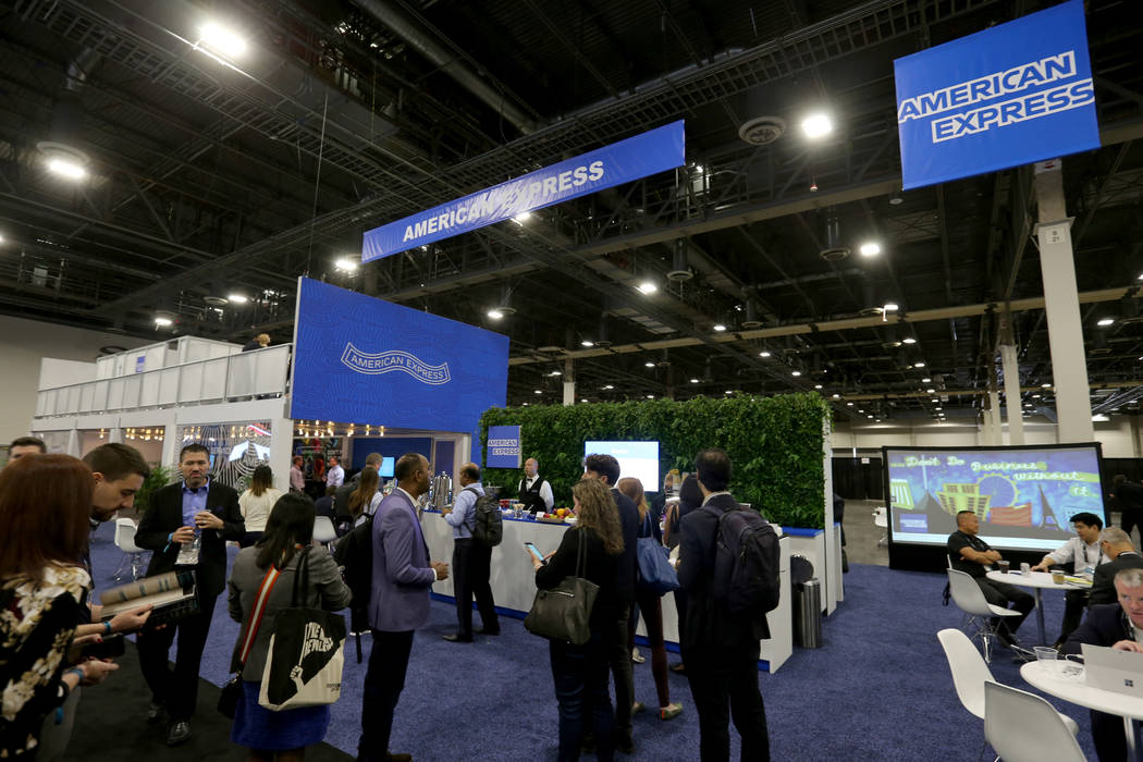 K.M. Cannon Las Vegas Review-Journal Conventioneers mingle at the American Express lounge at t ...