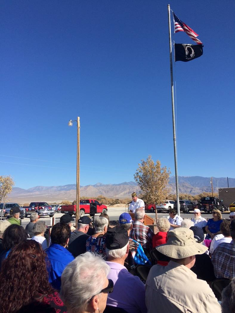 Robin Hebrock/Pahrump Valley Times The American flag and POW/MIA flag fly over the audience at ...