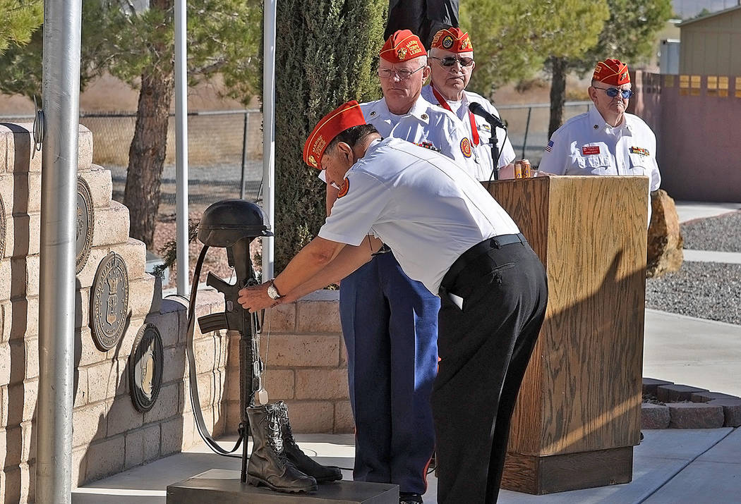 Horace Langford Jr./Pahrump Valley Times Marine Corps member Jose Telles places honorary Dog T ...