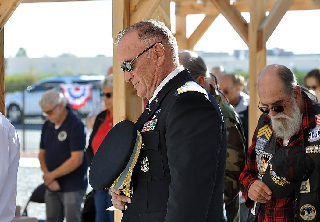 Horace Langford Jr./Pahrump Valley Times Pahrump veteran Lt. Col. Patrick Nary bows his head a ...