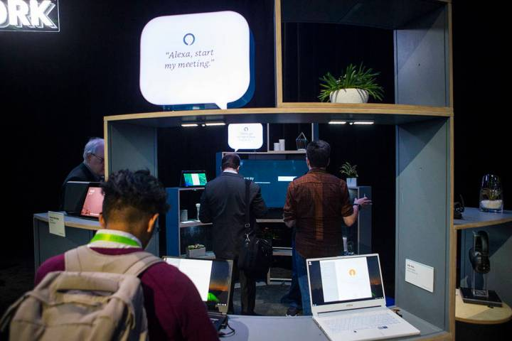 Attendees explore a room showcasing products integrated with Amazon's Alexa at the Sands Expo a ...