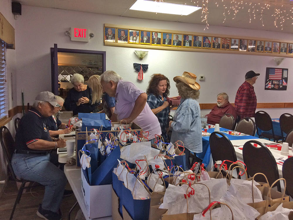 Robin Hebrock/Pahrump Valley Times Veterans are seen signing in for a dinner hosted in their ho ...