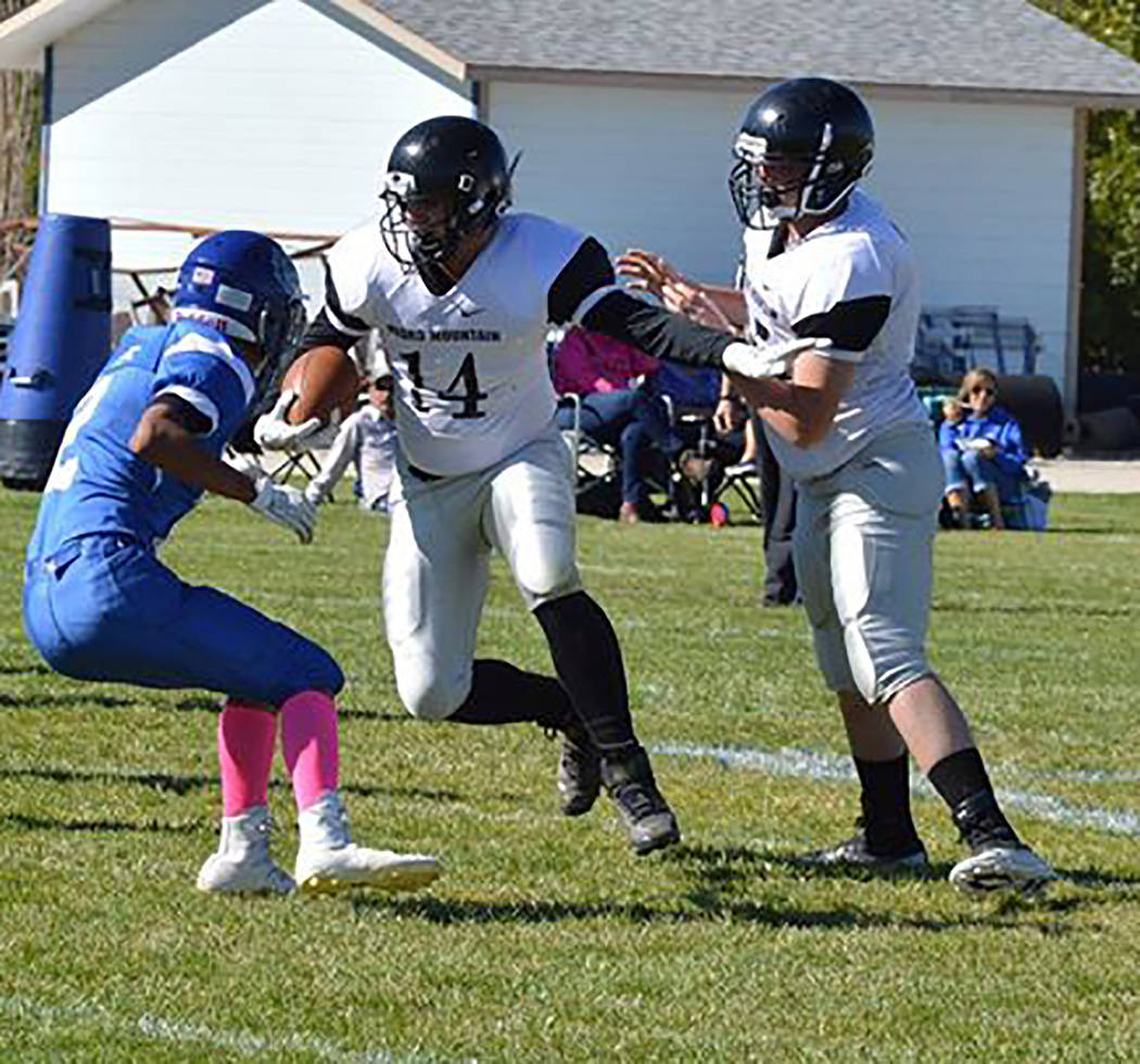 Special to the Times-Bonanza & Goldfield News Then-senior Drew Stewart (14) looks for running r ...