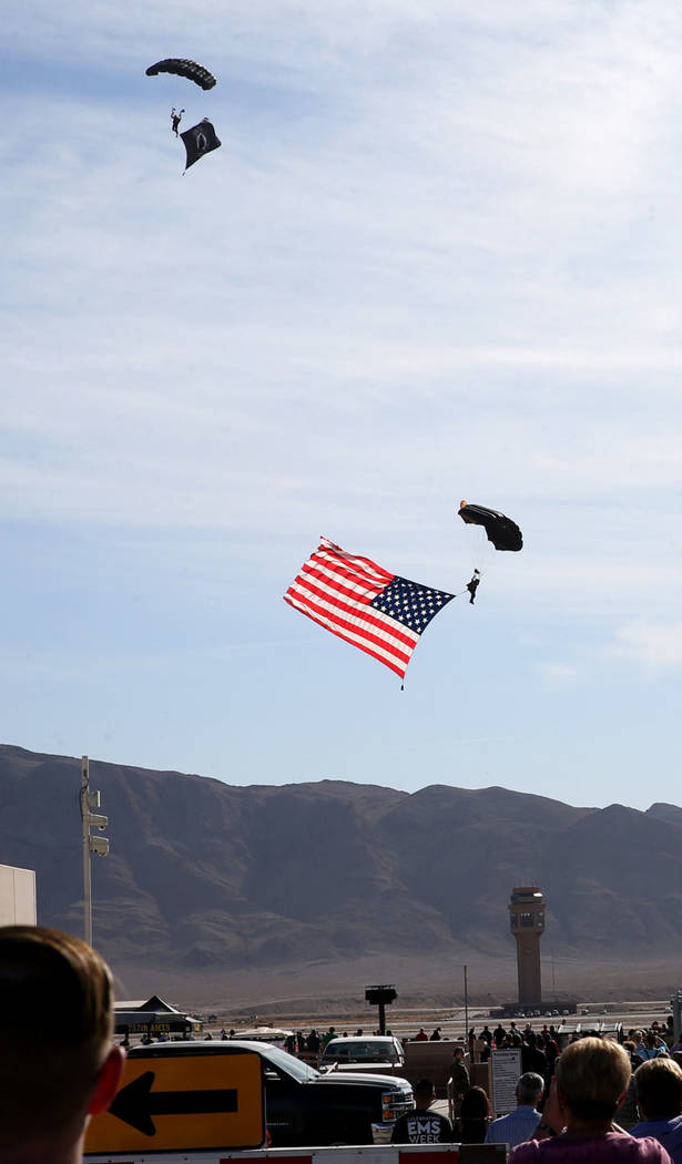 Airmen and guests stand for the American flag at Aviation Nation 2019 Air Show preview at Nelli ...