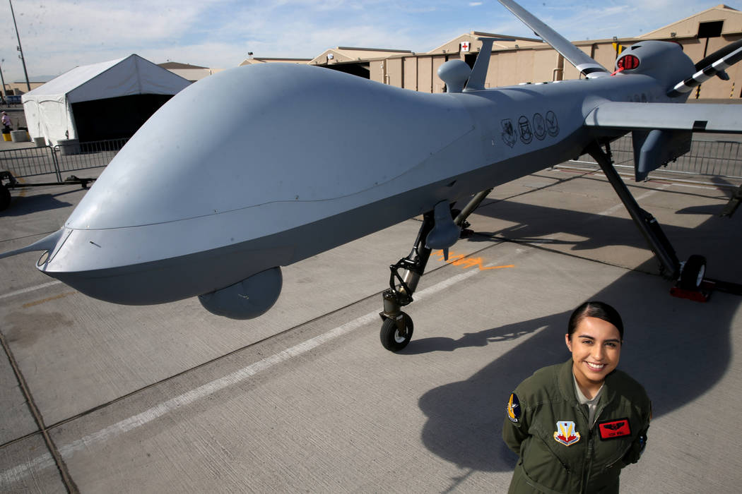 Sensor Operator Airman 1st Class Jackie with an MQ9 remotely piloted aircraft she helps fly at ...