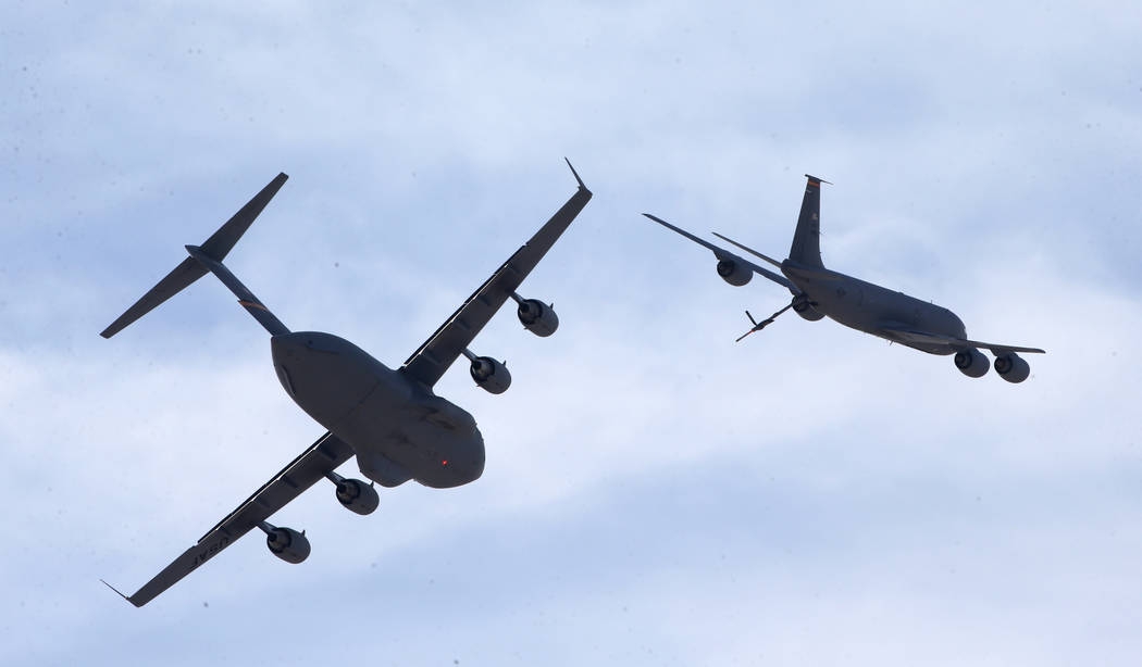 A KC-135, right, flies away from a C17 after demonstrating mid-air fueling at Aviation Nation 2 ...