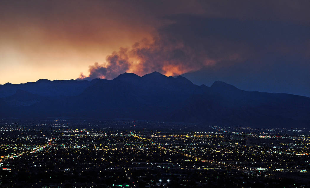 Smoke rises from the Carpenter 1 wildfire as the sun sets over Las Vegas on July 9, 2013. (Davi ...