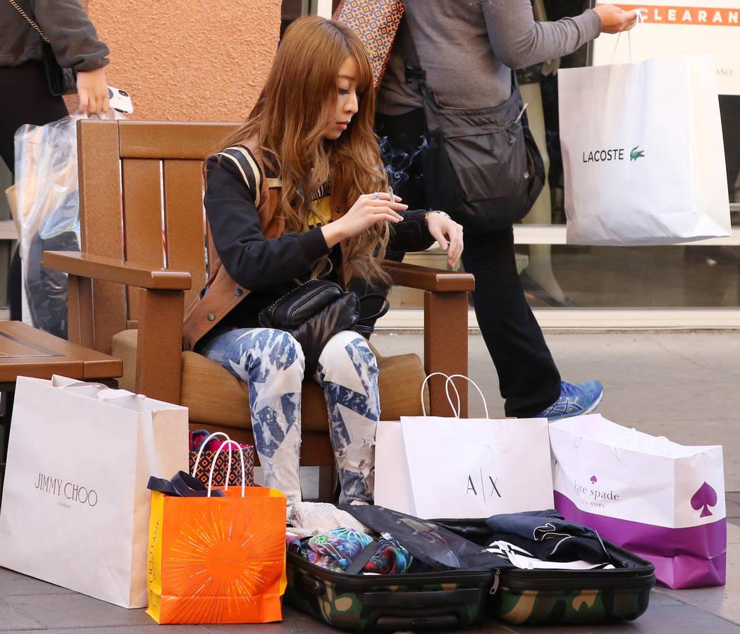 Bizuayehu Tesfaye/Las Vegas Review-Journal file Rie Takeuchi of Japan takes a break after shopp ...