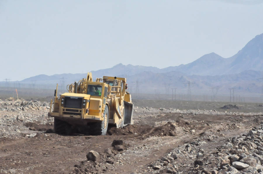 GridLiance/Special to the Pahrump Valley Times Construction crews work at a project to raise th ...