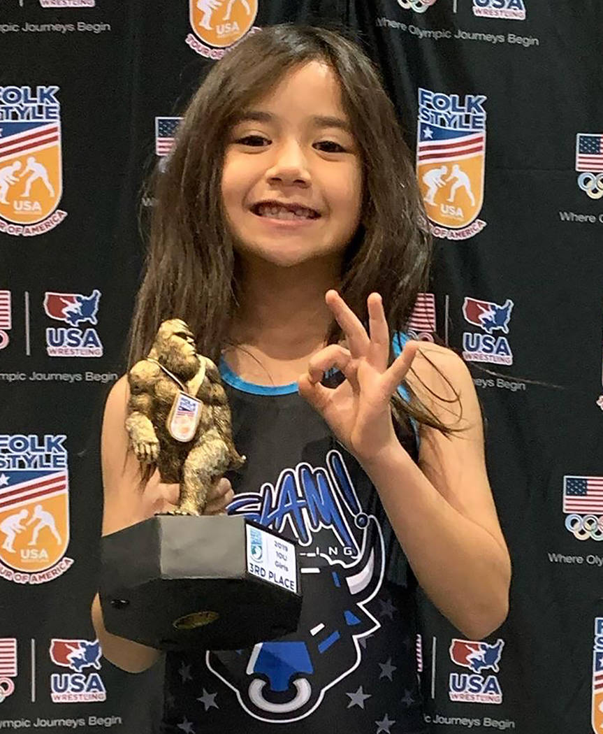 Special to the Pahrump Valley Times Suri Yoffee, 8, flashes three fingers, signifying her third ...