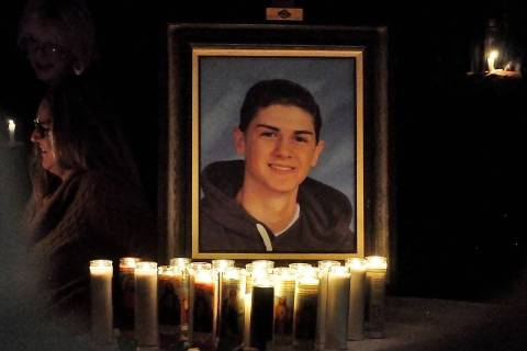 Horace Langford Jr./Pahrump Valley Times A candlelit shrine bearing Ethan Osterman's image w ...