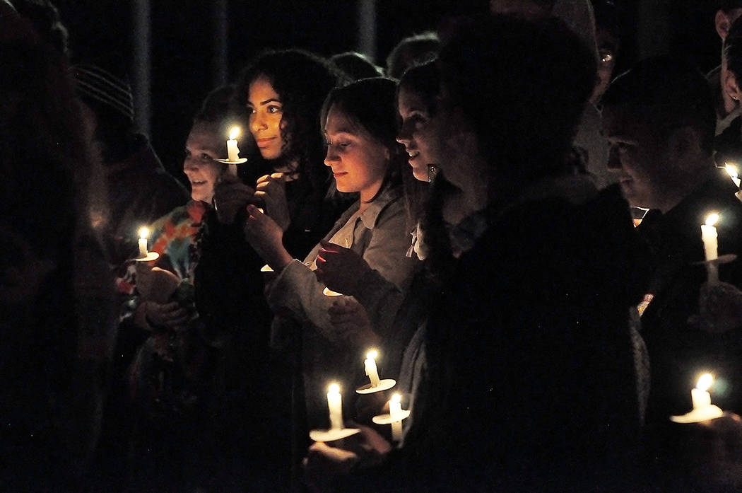 Horace Langford Jr./Pahrump Valley Times Those who attended the candlelight vigil remembered th ...