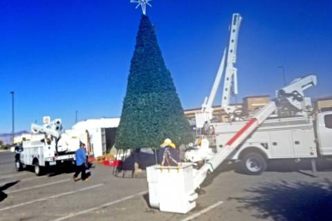 David Jacobs/Pahrump Valley Times Pahrump's community Christmas tree was being put into place ...