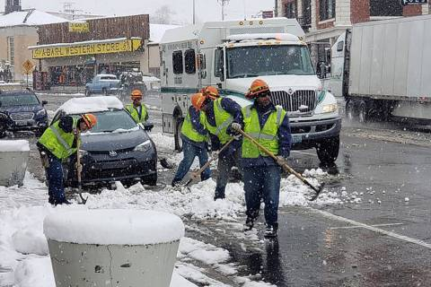 Nancy Whipperman/Pahrump Valley Times Crews remove snow in Tonopah on Nov. 21 as a storm moved ...