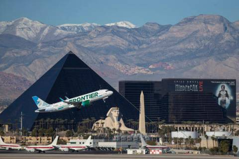A Frontier Airlines flight departs McCarran International Airport in Las Vegas, Sunday, January ...