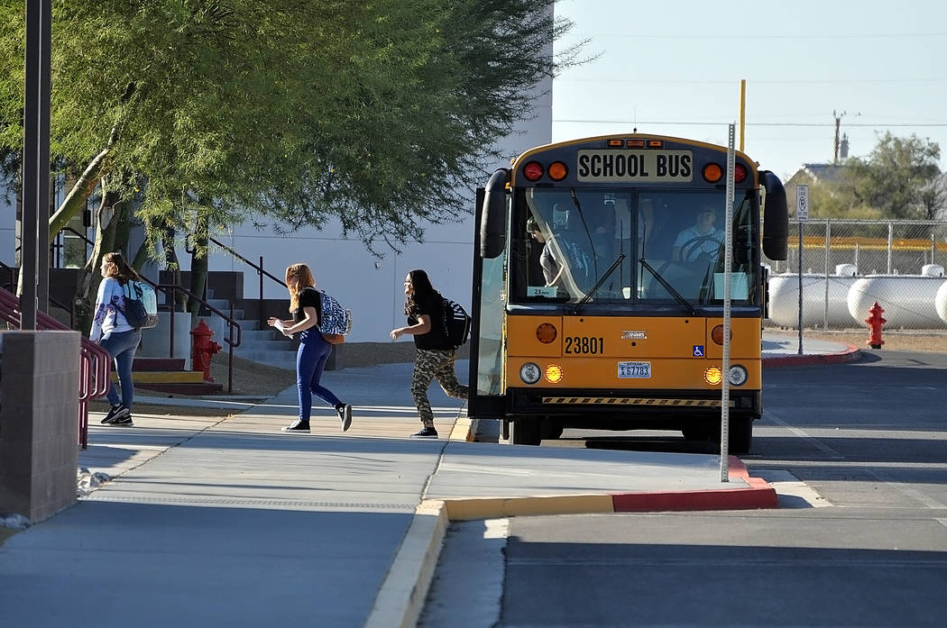 Horace Langford Jr./Pahrump Valley Times Students getting dropped off at Pahrump Valley High S ...