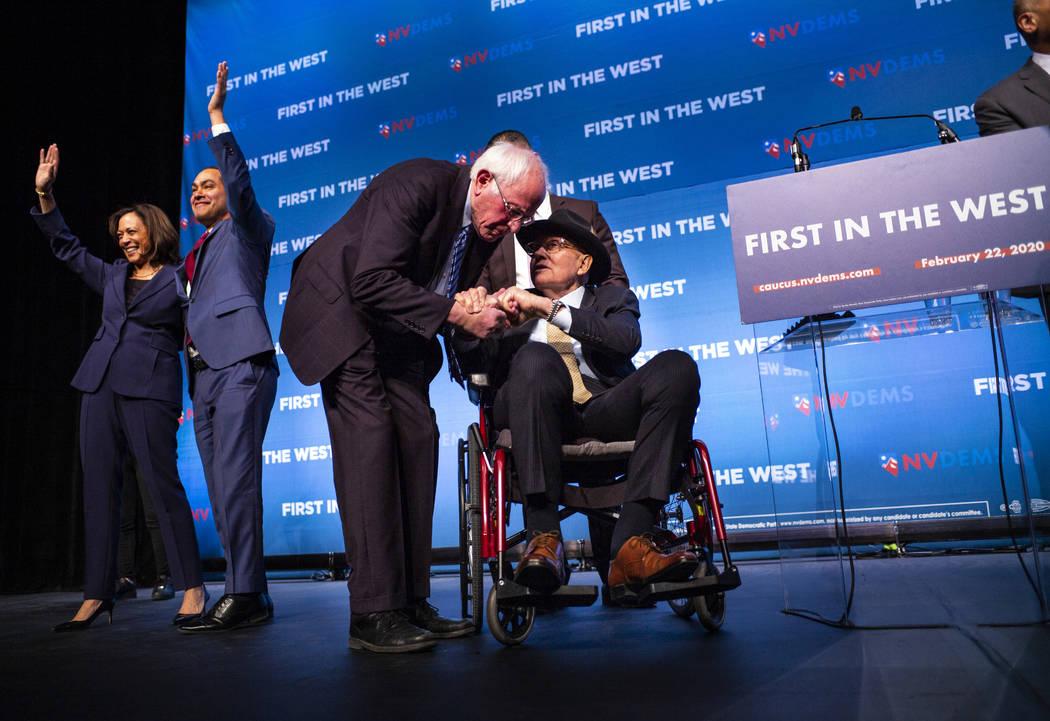 Democratic presidential candidate Sen. Bernie Sanders, I-Vt., center left, greets U.S. Sen. Har ...