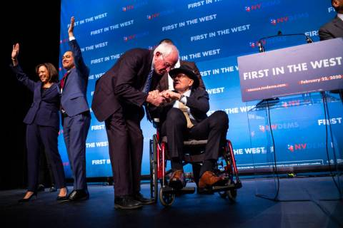 Democratic presidential candidate Sen. Bernie Sanders, I-Vt., center left, greets U.S. Sen. Har ...