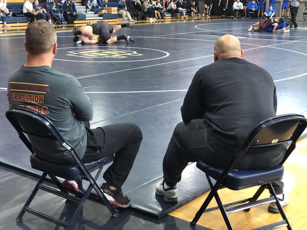 Tom Rysinski/Pahrump Valley Times Pahrump Valley High School wrestling coach Craig Rieger, left ...