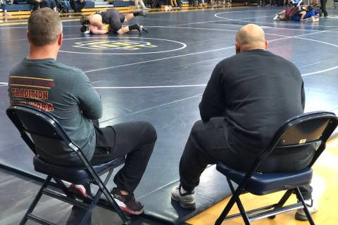 Tom Rysinski/Pahrump Valley Times Pahrump Valley High School wrestling coach Craig Rieger, left ...