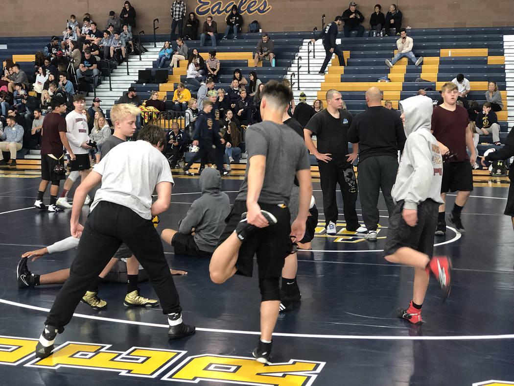 Tom Rysinski/Pahrump Valley Times Pahrump Valley High School wrestlers stretch between matches ...