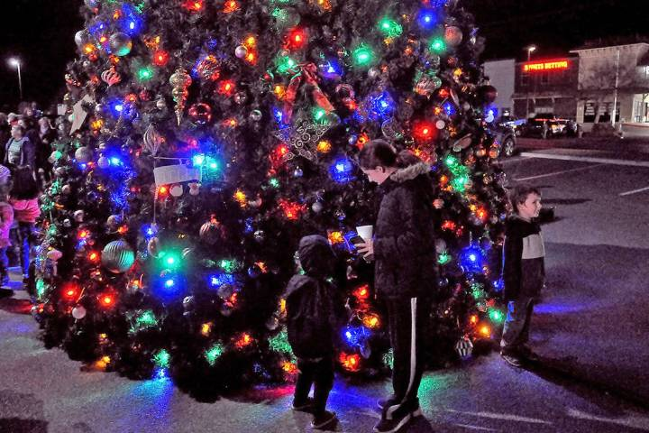 Horace Langford Jr./Pahrump Valley Times Bathed in the glow of festive lights, captivated young ...