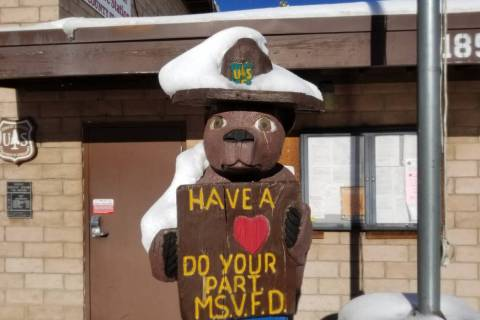 David Jacobs/Pahrump Valley Times Snow rests on the ranger hat of Smokey Bear at Mountain Sprin ...