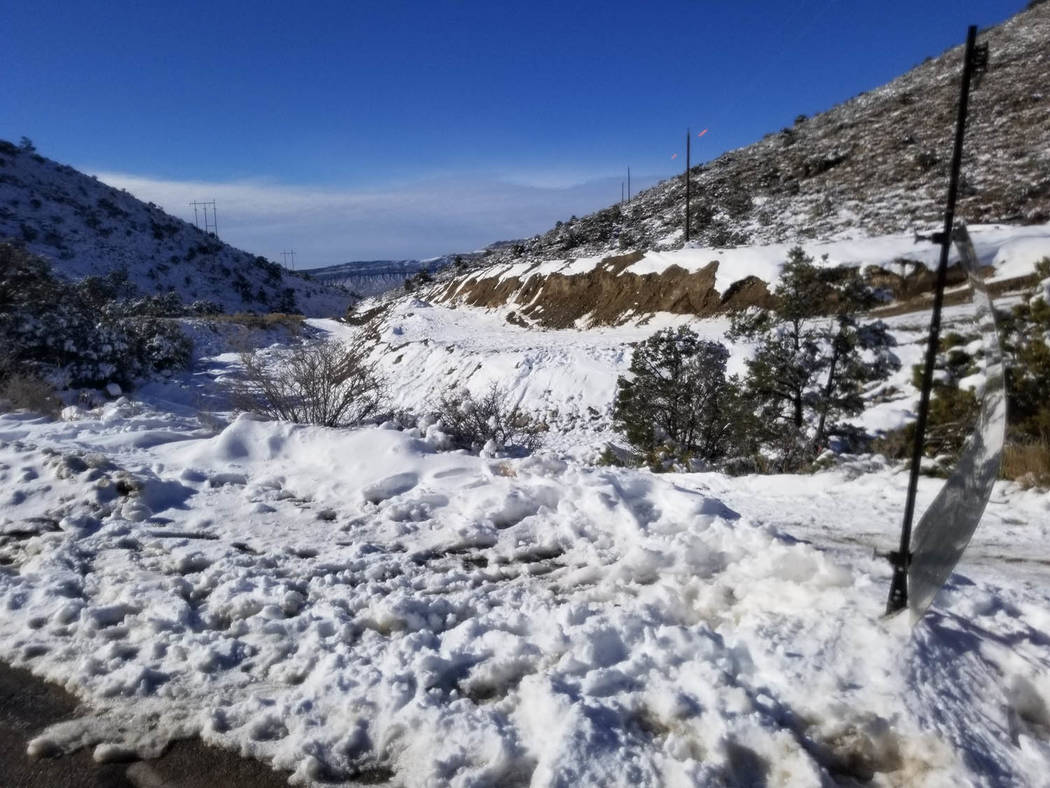 David Jacobs/Pahrump Valley Times Snow glistens off the landscape in the Mountain Springs commu ...