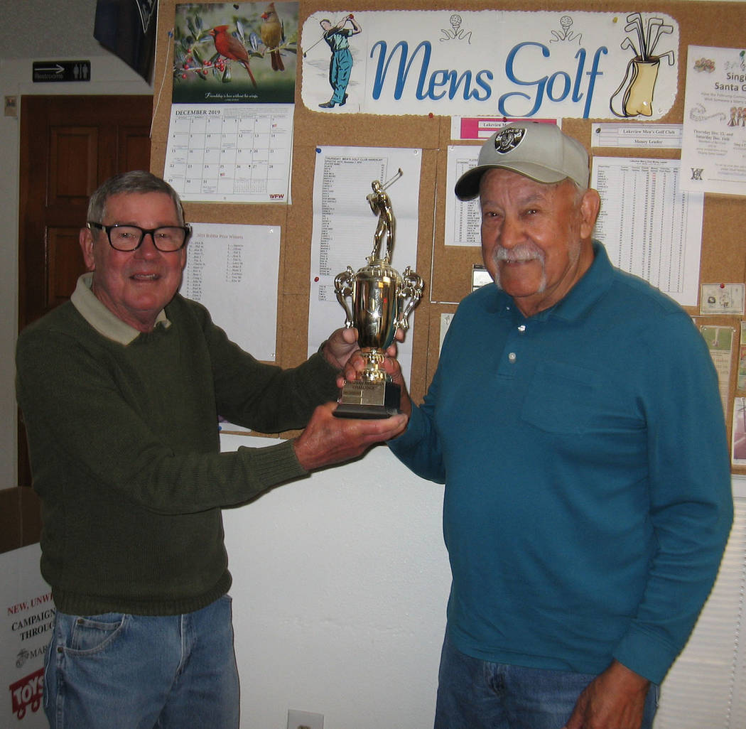 Special to the Pahrump Valley Times Tournament director Ed Plavac, left, presents Lorenzo Alvar ...
