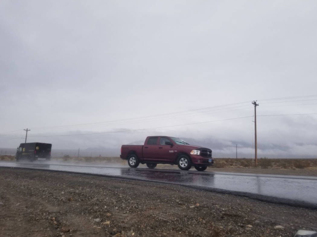 David Jacobs/Pahrump Valley Times Rain slickens Nevada Highway 160 in Pahrump as shown in this ...